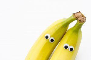 Two bananas with googly eyes.