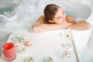 Woman relaxing in tub.