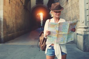 Woman reading map.