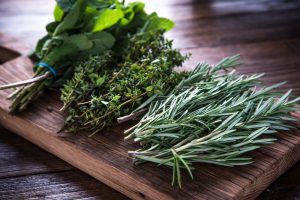 herbs on chopping board.