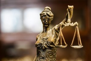 Woman holding justice scales.