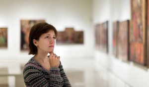 Woman looking at art.