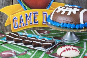 table with football shaped brownies and cake