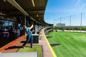 man getting ball at Top Golf