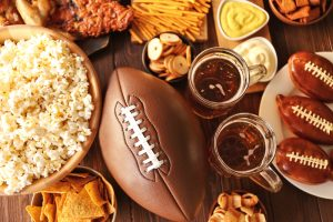 table full of snacks and football
