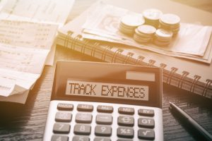 Calculator tracking expenses.