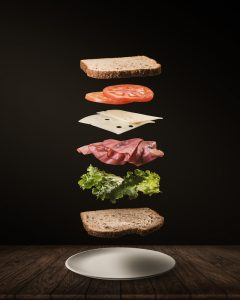 Dismantled sandwich parts floating.