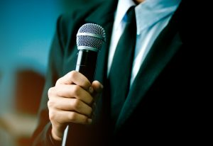 Guy holding microphone.