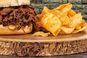BBQ sandwich and potato chips.