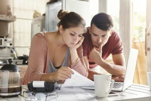 Young couple paying bills.