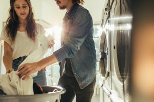 Young couple doing laundry.