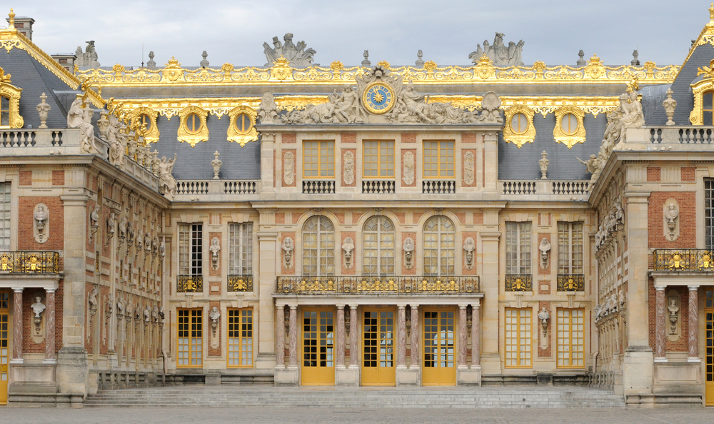 Front, up-close view of the Palace of Versailles in France.