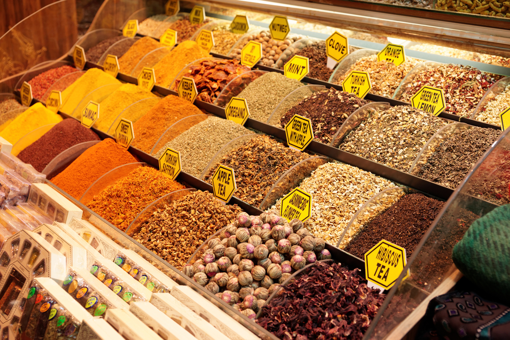 Rows of spices in a grocery store.