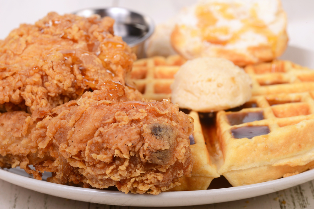 Closeup of Chicken and Waffles with butter and syrup