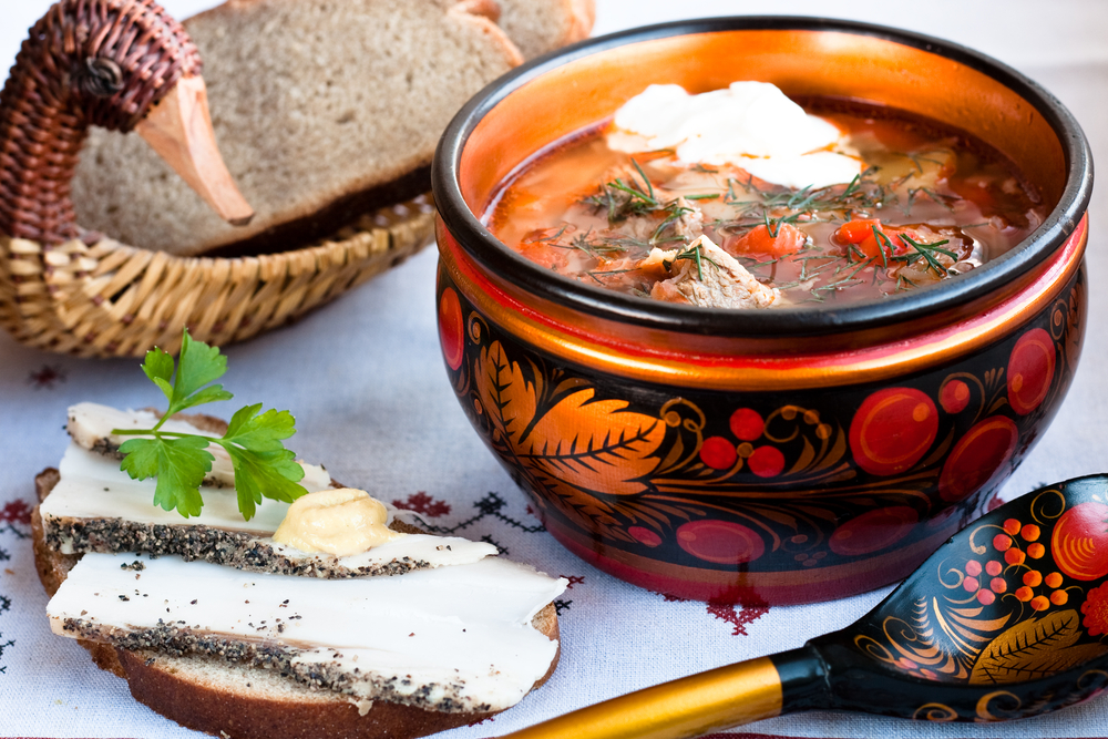 Russian borscht, fish, and bread.