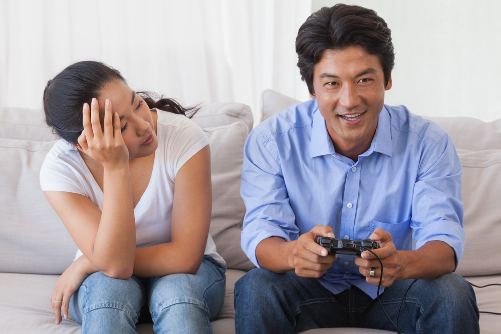 Girl annoyed at boyfriend's video game.