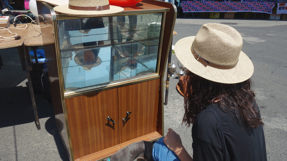 Picker examines mirrored antique chest.