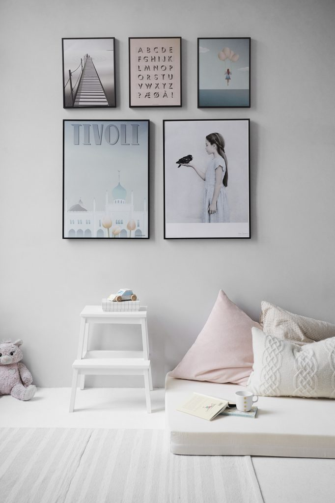 Gallery-style bedroom wall.