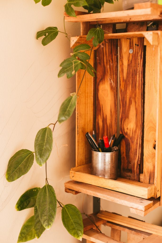 Wooden crate plant shelf.