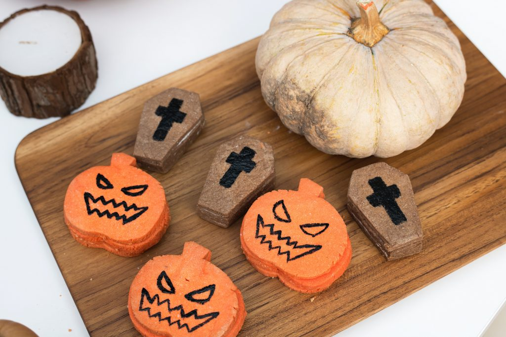 Pumpkin and coffin shaped treats for Halloween.