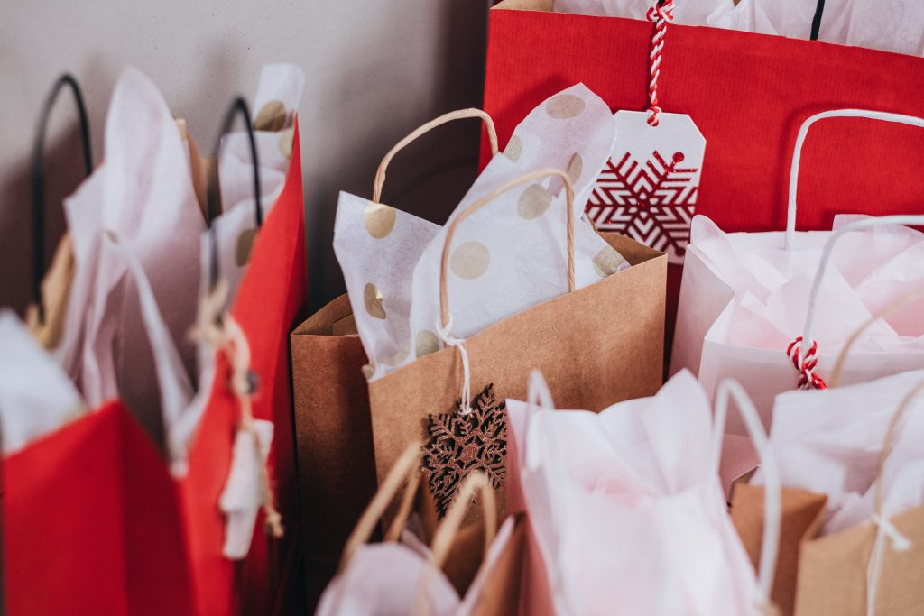 Several holiday gift bags.
