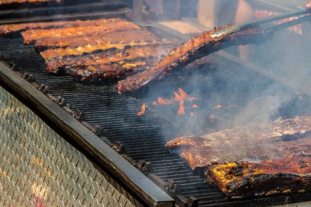 Flipping grilling ribs.
