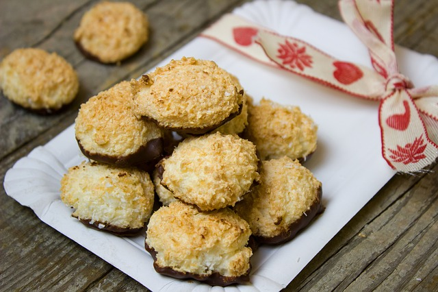 Chocolate coconut cookies piled on a square white plate.