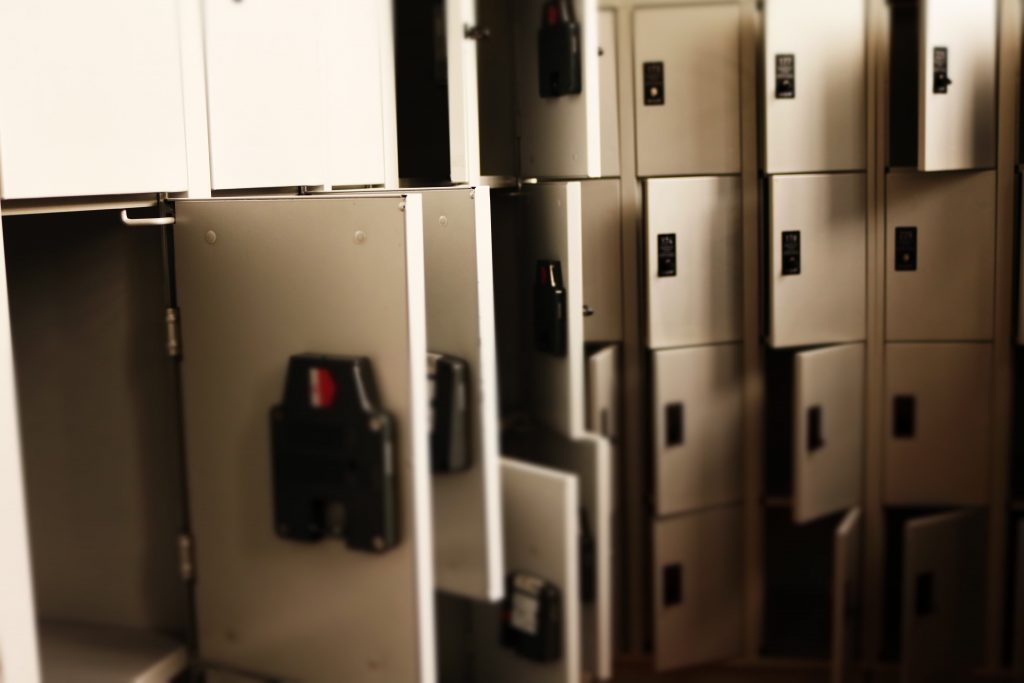 Row of open gray safety deposit boxes.