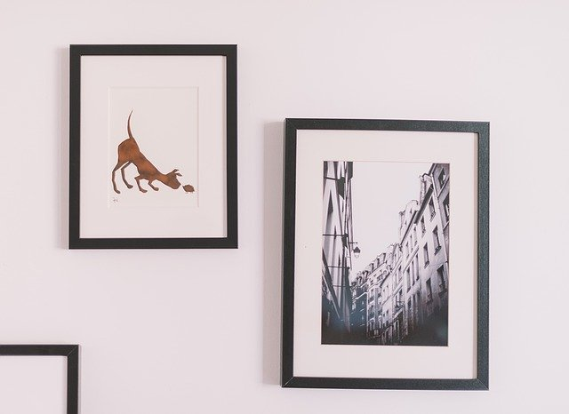 Framed black-and-white photo and drawing of dog