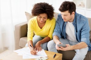 Woman and man discussing finances.