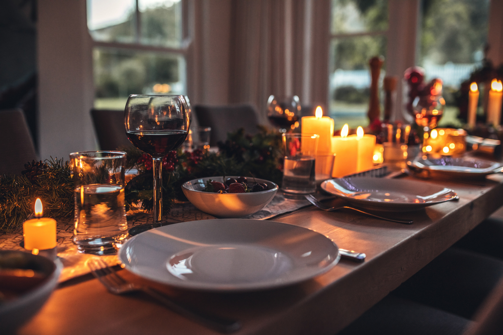 A dining table with candles.