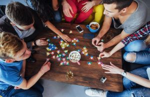 Friends playing a board game.